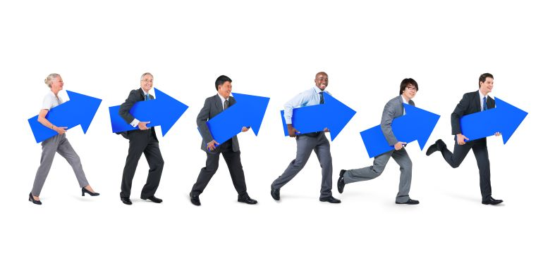 Different people carrying blue arrows pointing upwards.
