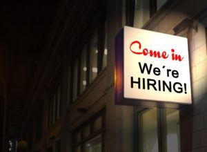 "See all the ""We're Hiring"" signs and never be afraid to come in and explore them during your moving jobs search NYC."