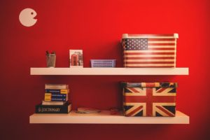 Boxes with American and British flag on a shelf - gettin along.