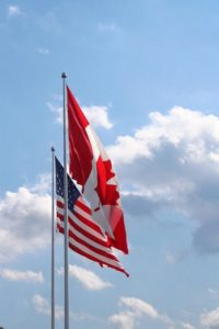 American and Canadian flags next to each other.