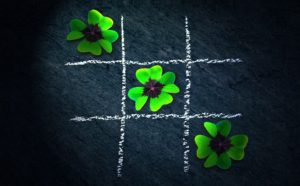 X-O with four-leaf clovers - make the smart calls when you build your small business.