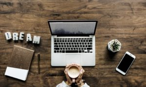 Coffee, laptop, smart phone, notebook and a dream - all it takes for a good ranking of your pages.