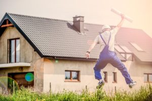 Contractor jumping with happines - one of the many bonus services movers should consider offering.