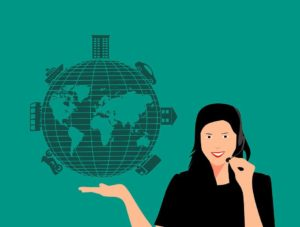 Woman holding the globe with transportation vehicles on it.