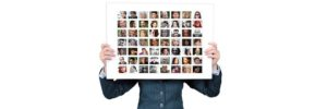 Woman holding a panel with small images of different people - double your website traffic with the help of others.