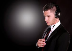 Businessman with headphones on.