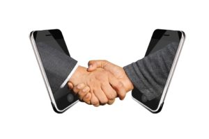 A handshake makes moving services lead to sales.