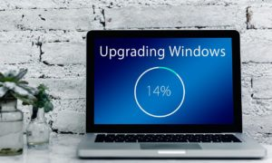 Laptop screen showing a 14% Windows upgrade in progress