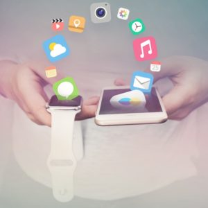Apple wrist watch connecting to iPhone - the basis of omnichannel marketing strategy.