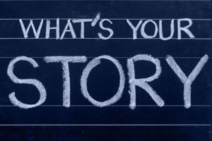 What's Your Story written in chalk on blackboard