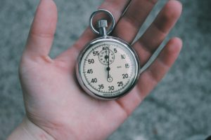 Stopwatch in the palm of a hand