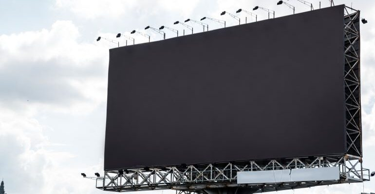 A blank billboard as a medium you can use to advertise your moving business.