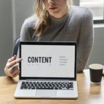 Woman pointing on Content page on laptop