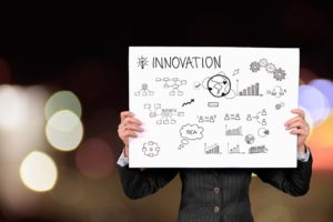 Businesswoman holding an Innovation schematic.