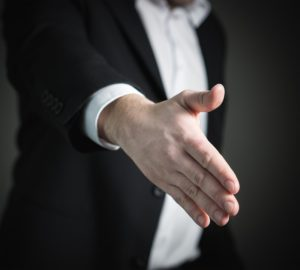 Businessman with his hand out.