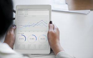 Woman looking at SEO growth chart.