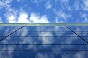 Glass business building with blue sky above