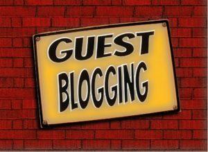 Guest blogging written in black letters ona brick wall.