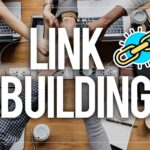 Link building wiritten in white letters over a picture of a few employees in an office