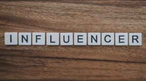 the word influencer written with white dices