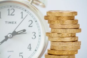 a clock and a pile of coins