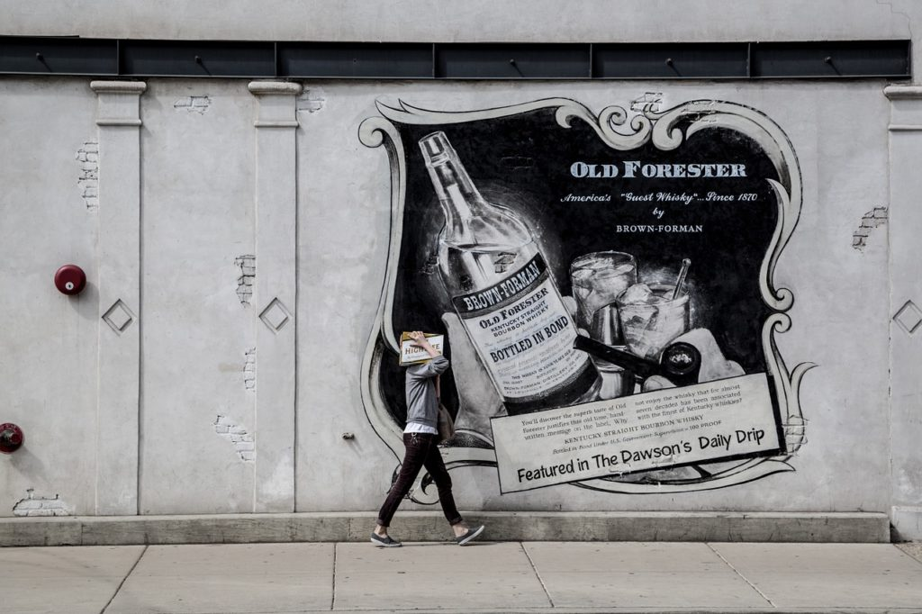 Advertisement painted on a street wall.