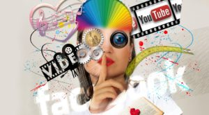 A girl surrounded by different aspects of advertizing like Youtube, video, colors, Facebook, etc.