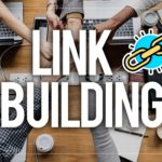 """Intertwined hands of several people, and the words """"Link Building"""" at the forefront of the image."""