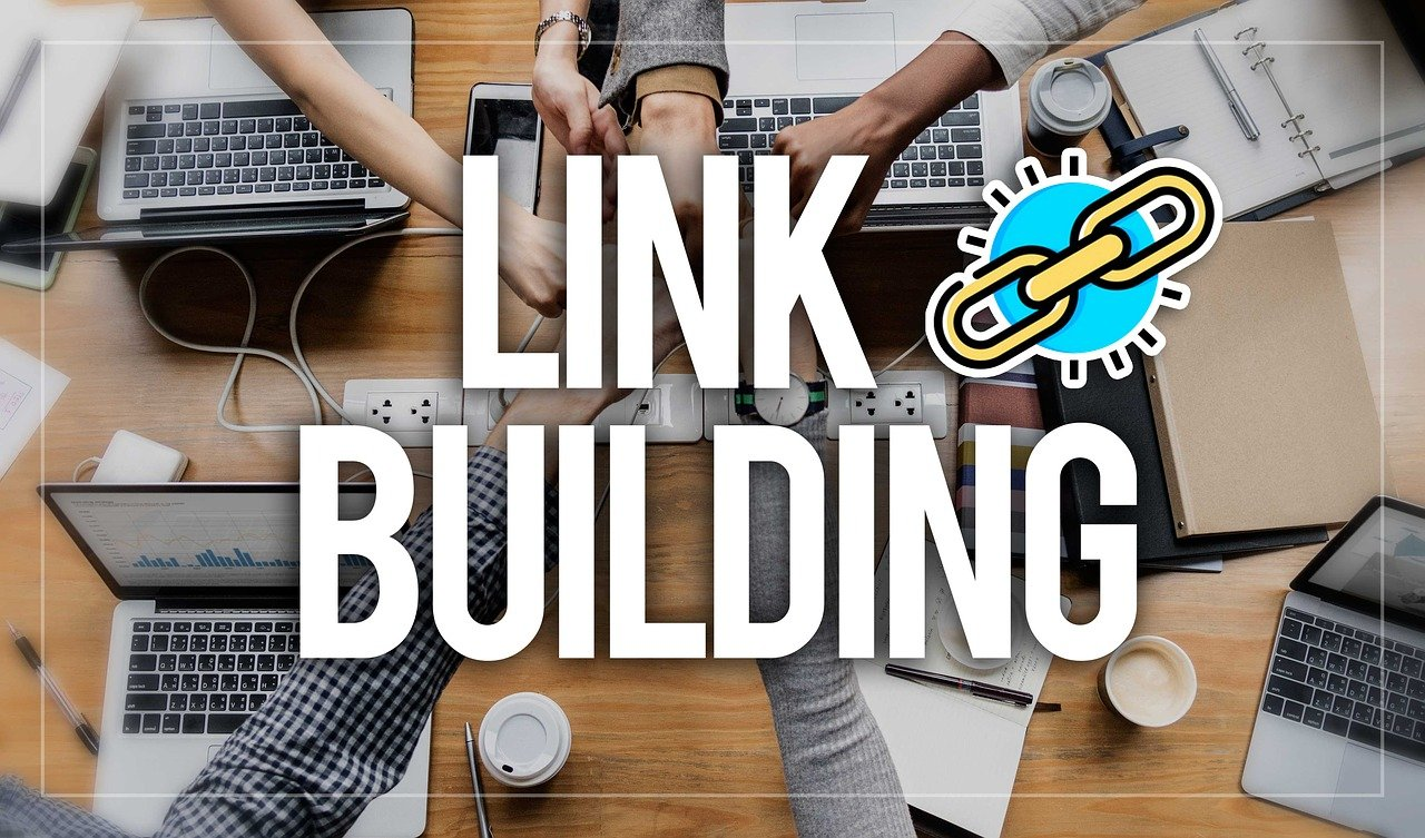 "Intertwined hands of several people, and the words ""Link Building"" at the forefront of the image."