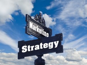A sign depicting Marketing and Strategy