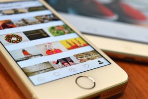 A smartphone with someone's Instagram profile opened; the color red is dominating in what is a thoroughly consistent aesthetic (perhaps the owner of this profile read our Instagram marketing tips).