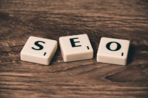 """Three cubes, together forming the word """"SEO""""."""