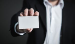 A businessman showing his blank business card.
