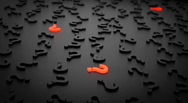 A bunch of question marks, symbolizing 5 reasons why your moving business is failing.