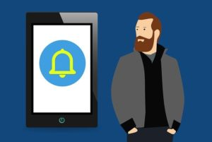 A drawing of a push notification on a mobile phone with a man standing next to it.