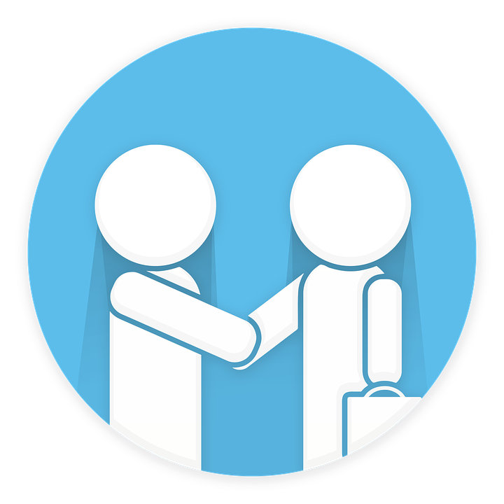 People shaking hands over the benefits of referral marketing