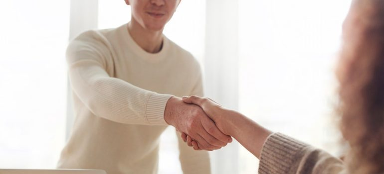Person shaking hands with a client