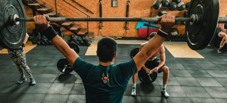 person lifting barbell