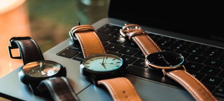Wrist watches on laptop
