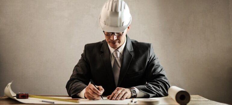 An image of a businessman with a protective helmet