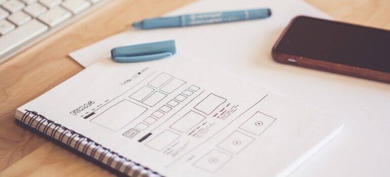 An image of sketches for a new website design in a notebook