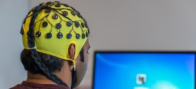 Person with an EEG neuro net on his head
