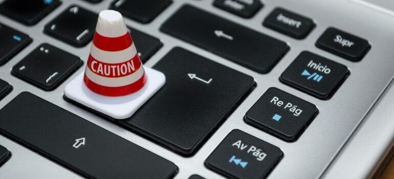 Image of a keyboard with traffic Caution cone on the Enter button