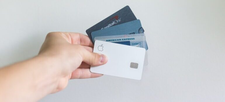 A series of credit cards, including Apple's white one, representing marketing fails.
