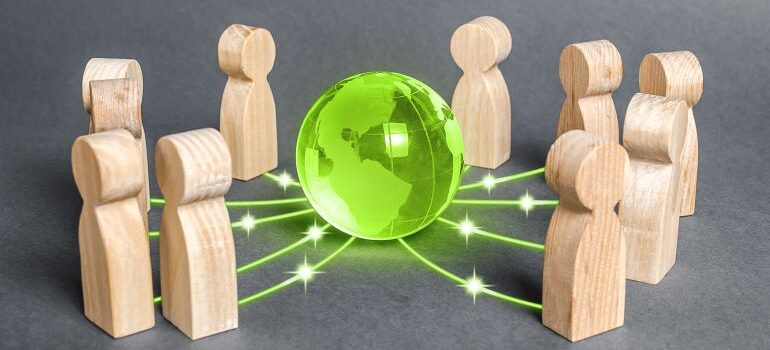 Illustration of pawns connected to a 3D model of Earth