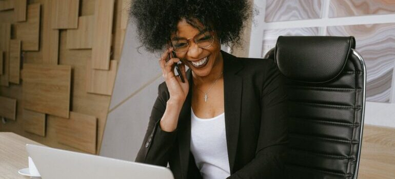 A woman talking on her phone and smiling.