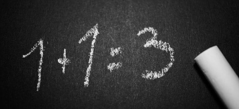 1+1=3 written in chalk.