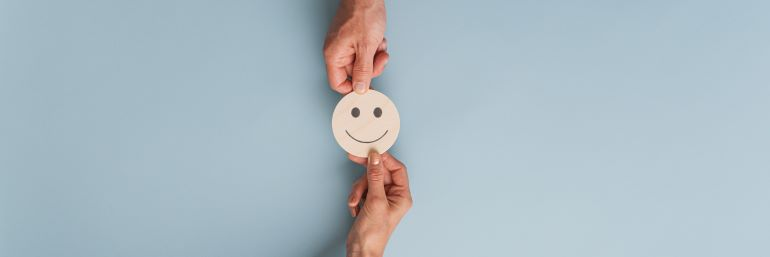 People exchanging a smiley face