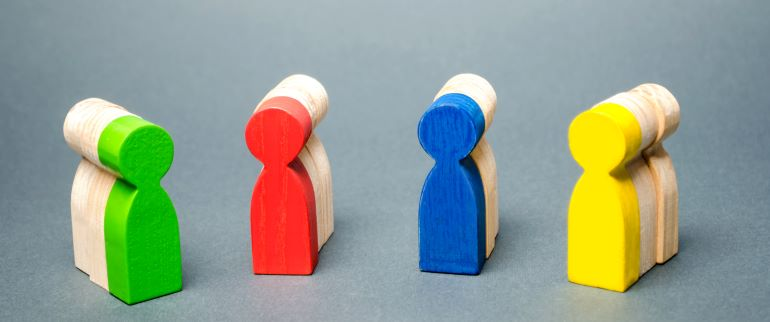 Differently colored pawns - green, red, blue, yellow.