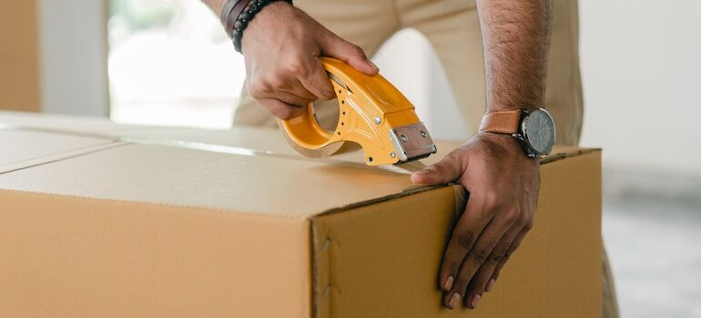Person packing a box.